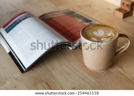 Coffee latte with a book in coffee shop - stock photo