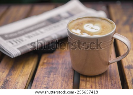 coffee latte with a newspaper - stock photo