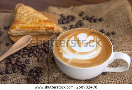 Coffee latte with bread - stock photo
