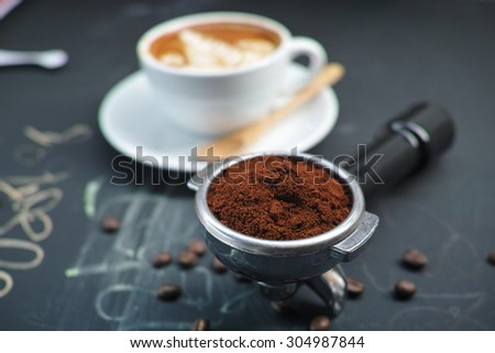 coffee latte with coffee beans on the black background