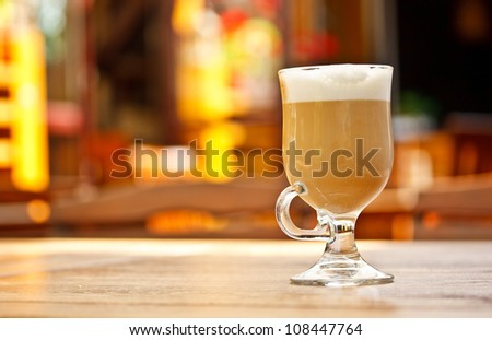 Coffee latte with lights on background