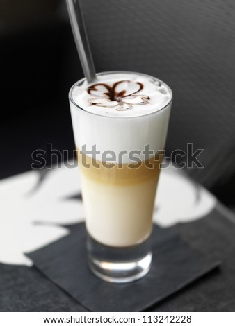 Coffee macchiato - coffe with milk - stock photo
