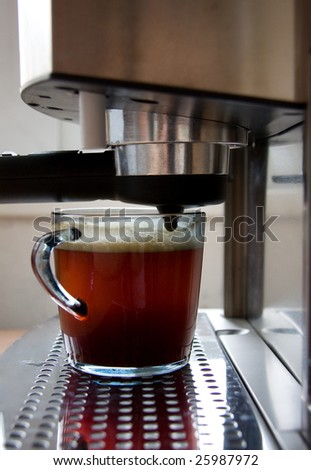 Coffee machine and a cup of coffee