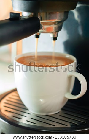 coffee machine and cup of coffee - stock photo