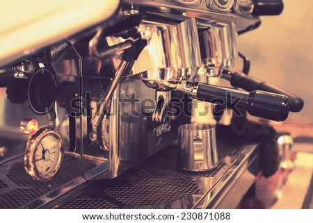 coffee machine in vintage color toned - stock photo