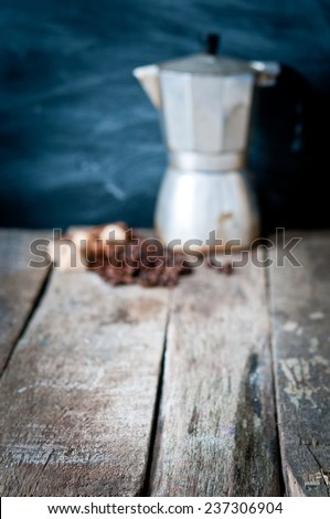 Coffee maker on blackboard background - stock photo