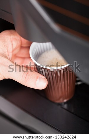 Coffee maker pouring hot espresso coffee in a glass - stock photo