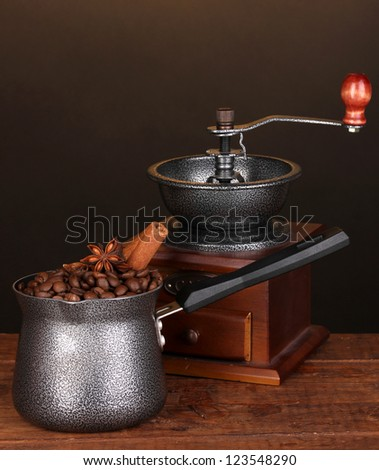 Coffee maker with coffe mill on wooden table - stock photo