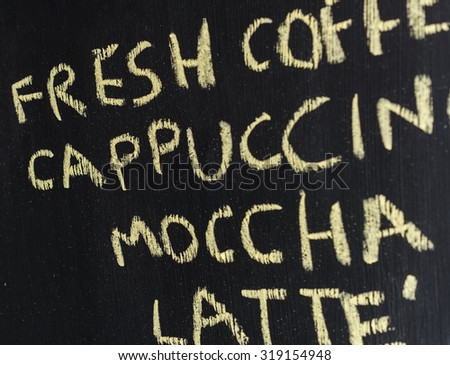 Coffee menu on blackboard - stock photo