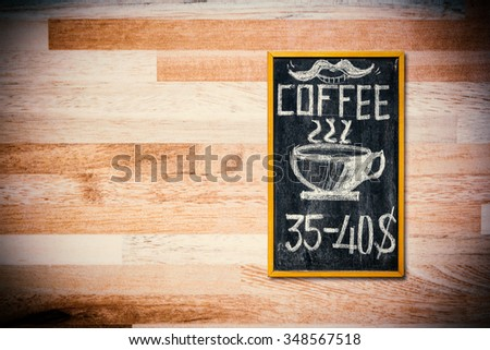 Coffee menu on wood wall, Hand drawing coffee price on blackboard