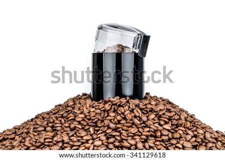 Coffee mill and pile of coffee beans isolated on white - stock photo