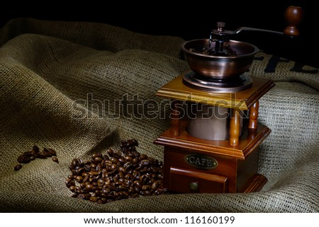 Coffee Mill with beans and burlap. still life
