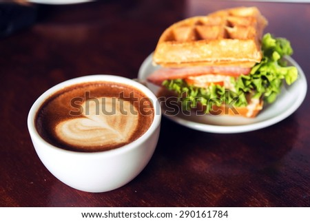 coffee mocha hot and coffee beans on wooden table on brown background - stock photo