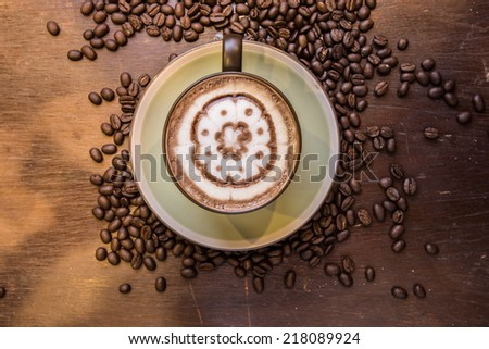coffee mocha with coffee coffee beans on wooden table - stock photo
