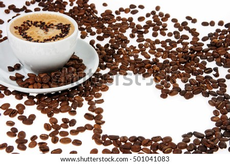 coffee mug against the backdrop of coffee beans