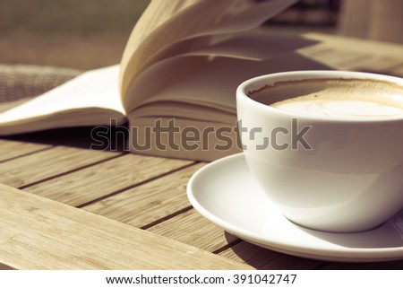 Coffee Mug and a Book on a Wooden Table