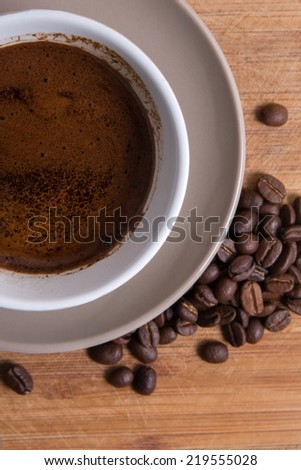 coffee mug and beans closeup