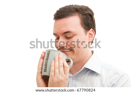 Coffee mug held contently by a caucasian male in a business shirt