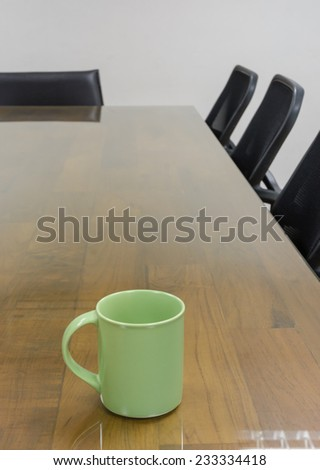 coffee mug on table at meeting room - stock photo