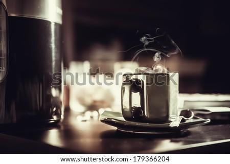 Coffee mug on the table. - stock photo