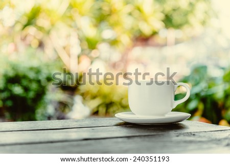 Coffee mug on wooden table - Vintage effect style pictures