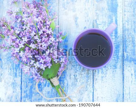 coffee mug spring flowers vintage background - stock photo