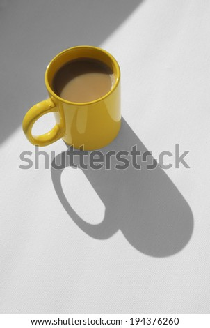 coffee mug with cappuccino on light grey background. Mimimalistic studio shoot. High Angle View - stock photo