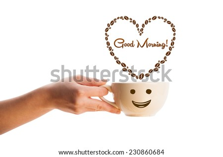Coffee mug with coffee beans shaped heart with good morning sign, isolated on white - stock photo