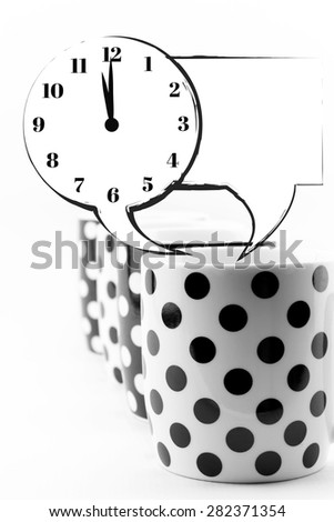 Coffee mugs with speech bubbles and clock isolated - stock photo