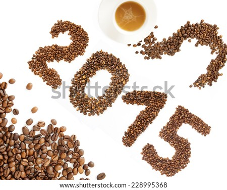 Coffee New Year. Cup of coffee and coffee beans isolated on white background - stock photo