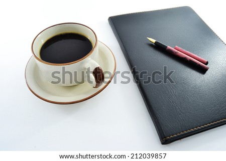 coffee, notebook and pen