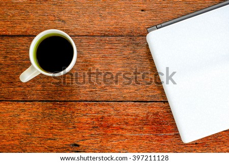 Coffee , Notebook , Dark on wooden desk top view.Copy space for message.