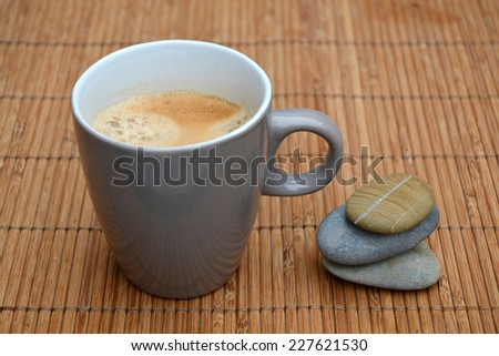 coffee on a old wood background with zen stones, coffee break - stock photo