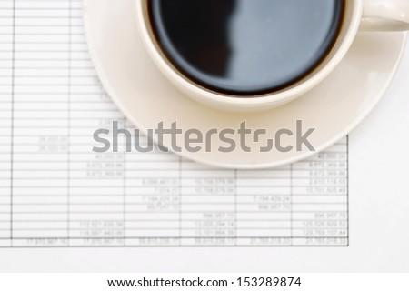 Coffee on documents. - stock photo