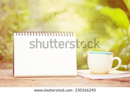 Coffee on notebook and Empty calendar - stock photo