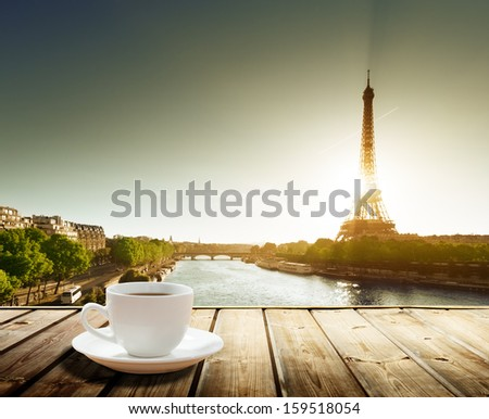 coffee on table and Eiffel tower in Paris  - stock photo