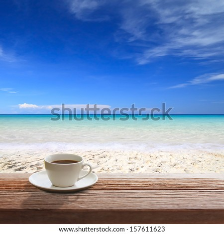 Coffee on table wood in the beach