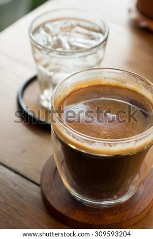 Coffee on the tabletop with water