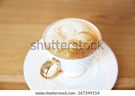 coffee on wood background - stock photo