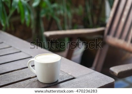 coffee on wood table and morning light background