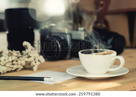 coffee on wood table in coffee shop vintage effect - stock photo