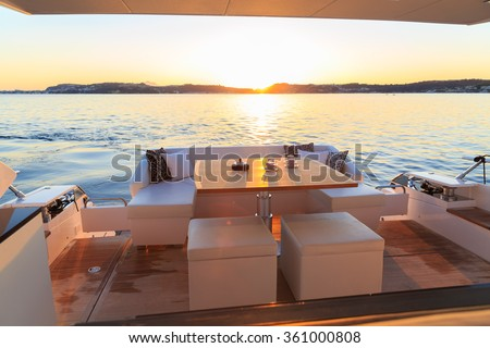 coffee on yacht at sunset - stock photo