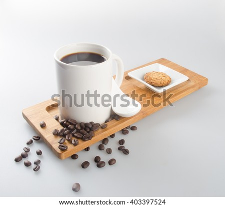 coffee or coffee and chocolate cookie on background - stock photo