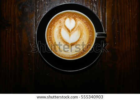 coffee or latte in a coffee cup. latte art