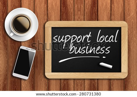 coffee, phone and chalkboard with make support local business words. - stock photo