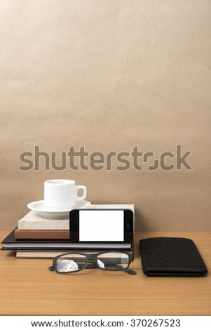 coffee,phone,eyeglasses,stack of book and wallet on wood table background
