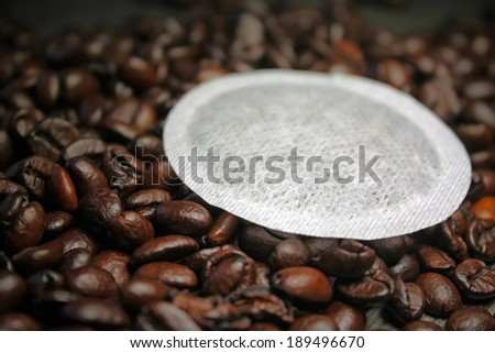 Coffee pods on coffee beans shallow DOF background - Coffe pods  modern filter coffee replacement - stock photo