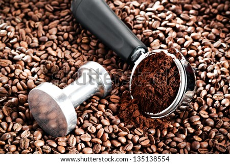 Coffee portafilter on coffee bean background - stock photo