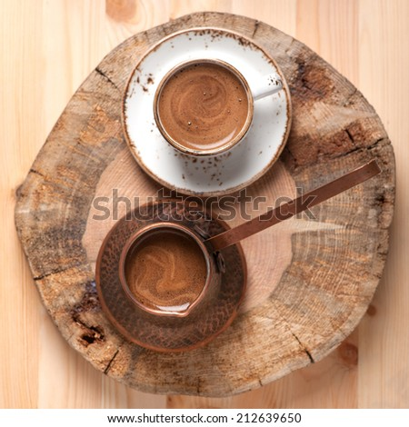 Coffee pot and cup of coffee  - stock photo