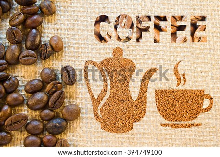 Coffee pot, cup and saucer and inscription coffee  lined with coffee beans and ground coffee on a background a sacking - stock photo